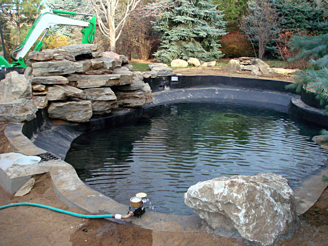 Spray line technologies sprayline technologies koi pond for Koi pond natural swimming pool